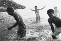 Teenagers splashing in the ocean - Jade Lee