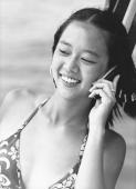 Teen girl talking on cellular phone, smiling - Jade Lee