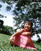 Girl sitting on grass, tree in background - Alex Microstock02