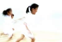 Children in white clothing running (motion blur) - Alex Microstock02