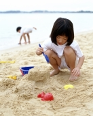 Girl playing at the beach - Alex Microstock02