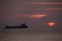 Vietnam, Vung Tau, oil tanker in the South China Sea at sunset. - Steve Raymer