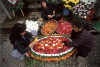 Vietnam, Hanoi, women making flower arrangements. - Steve Raymer