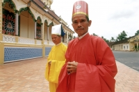 Vietnam, Tay Ninh, Cao Dai priests outside of Cao Dai Great Temple. - Steve Raymer