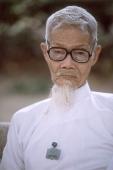 Vietnam, Tay Ninh, Cao Dai priest in white robe (close up). - Steve Raymer