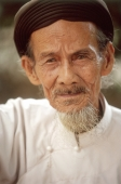 Vietnam, Tay Ninh, Cao Dai elderly worshipper (close up). - Steve Raymer