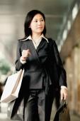 Woman carrying shopping bags - Gareth Brown