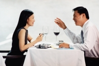 Male and female executives talking in restaurant - Jade Lee