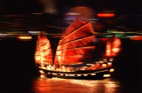 China, Hong Kong, Chinese Junk in Hong Kong Harbor at night - John McDermott