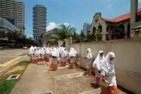 Singapore, Arab Street, Muslim students wearing traditional costume to Muslim school. - Steve Raymer