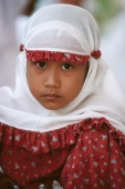 Indonesia, Aceh, Muslim girl in traditional prayer robes (close up). - Steve Raymer