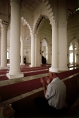 Malaysia, Johor Bahru, Muslim man pray at Sultan Abu Bakar Mosque. - Steve Raymer