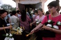 Cambodia, Phnom Penh, Mekong River, worshippers offer burnt incense. - Steve Raymer