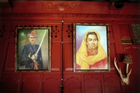 Indonesia, Aceh, Pictures of Acehnese royalty adorn the walls of a house in Banda Aceh. - Steve Raymer