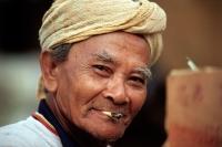 Malaysia, Kota Bahru, A Malay Muslim fisherman smokes a hand-rolled cigarette. - Steve Raymer