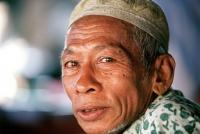 Malaysia, Kota Bahru, Muslim fisherman wears islamic skull cap. - Steve Raymer
