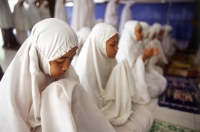 Indonesia, Jakarta, Students recite verses from the Koran at Asshiddiqiyah Islamic College. - Steve Raymer
