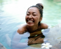 Woman in pool smiling - Jack Hollingsworth