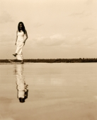 Reflection of woman in white dress kicking at water - Jack Hollingsworth