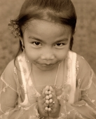 Indonesia, Bali, young girl, traditional greeting, portrait, elevated view - Jack Hollingsworth