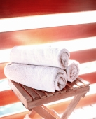 Rolled up towels sit on a folding table - Jack Hollingsworth