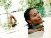 Woman in water, looking off camera. - Jack Hollingsworth