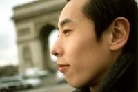 Profile of man, Arc de Triomphe in background. - Leila  Pivetta