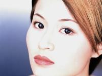 Portrait of young woman, close-up - Eric Ceret