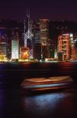 Hong Kong, Night view of Central across harbor. - Stuart Woods