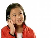 Young girl talking on cellular phone, white background. - Jade Lee