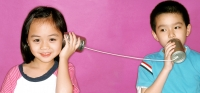 Children playing with tin can phone, purple background. - Jade Lee