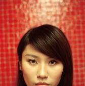 Young woman, portrait, orange/red background. - Jack Hollingsworth
