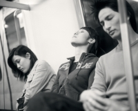 Young adults sleeping on train. - Jack Hollingsworth