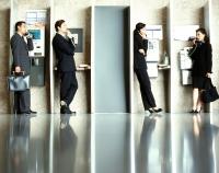Executives using public telephones. - Jack Hollingsworth