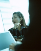 Female executive using PDA and talking. - Jack Hollingsworth