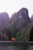 Vietnam, Halong Bay, Fishing junk sailing amongst the islands - Gareth Jones