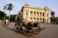 Vietnam, Hanoi, Cyclo outside the Municipal Theatre - Gareth Jones