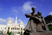 Vietnam, Saigon, Statue of Ho Chi-Minh with Hotel De Ville in background - Gareth Jones