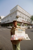Vietnam, Saigon, newspaper vendor outside Hotel Continental - Gareth Jones