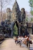 Cambodia, Angkor Thom, cyclists leaving the south gate - Gareth Jones
