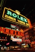 China, Hong Kong, Kowloon, Neon signs on Nathan Road at night - Gareth Jones