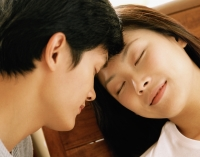 Couple with heads together, eyes closed - Jade Lee