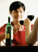 Man drinking wine with friend - Jade Lee