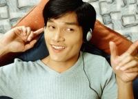 Man listening to headphones - Jade Lee