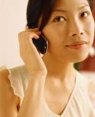 Woman using cellular phone - Jade Lee