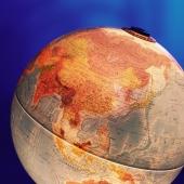 Globe, focus on China, blue background - Gareth Brown