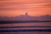 Indonesia, Bali, Kuta, Sunset over ocean, small boat in water - Jill Gocher