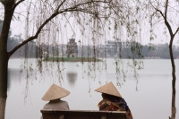 Vietnam, Hanoi, Two women sit on a bench overlooking Huan Kiem Lake. - Jill Gocher