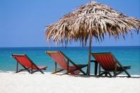 Vietnam, beach chairs and umbrella on Nha Trang Beach - Jill Gocher