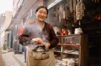 Nepal, Tibetan woman with juniper incense - Jill Gocher